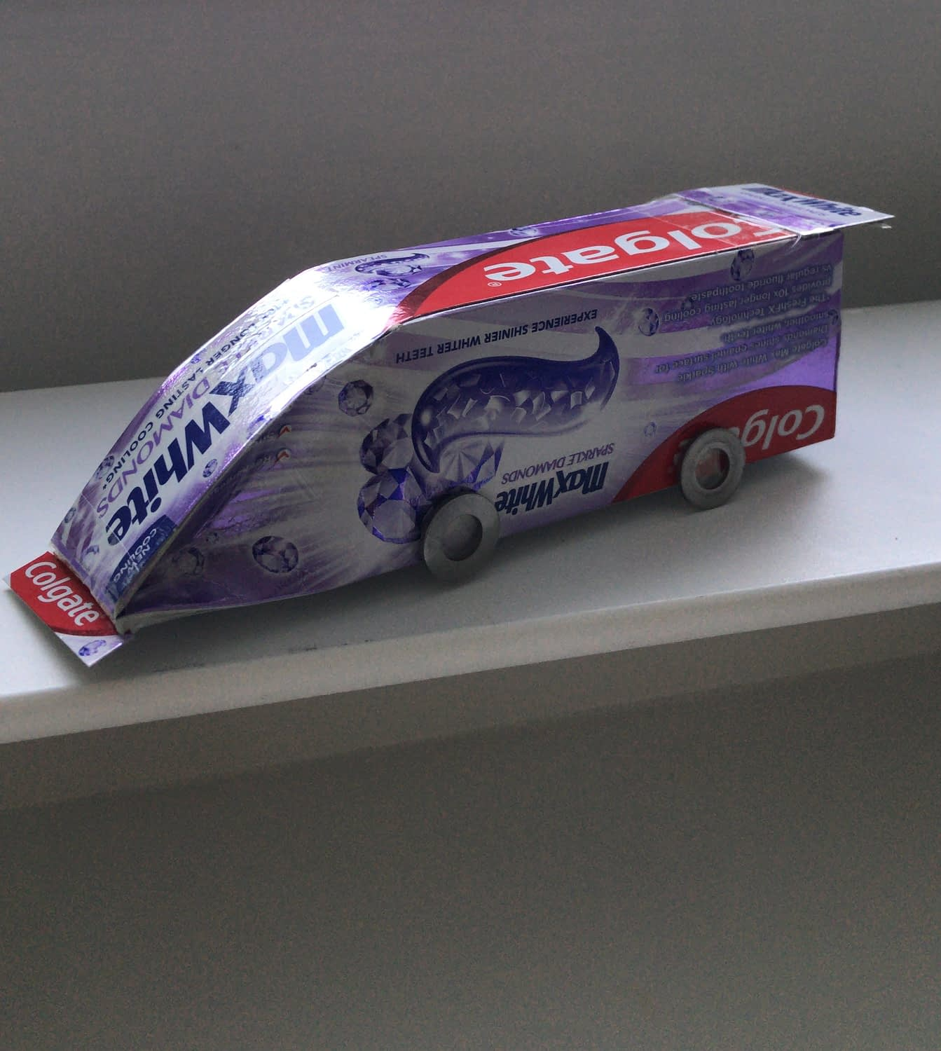 Toothpaste box turned into a race car